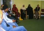 A group of community leaders debating educationalissues